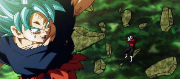 Son Goku nearly knocking Jiren out of the ring. [Image via JobNicK/YouTube screencap]