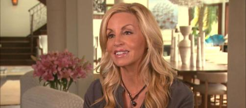 Camille Grammer participates in an interview at her L.A. home. [Photo via Entertainment Tonight/YouTube]