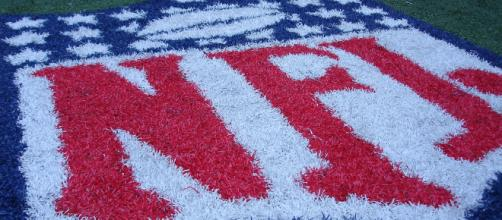 The NFL logo on the field. - [Photo credit to Jonathan Moreau via Flickr]