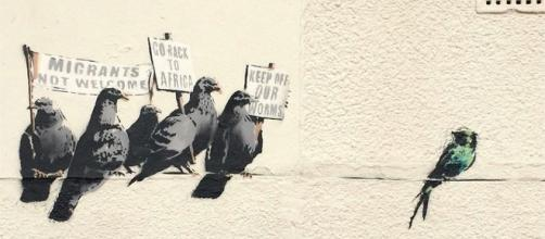 Pigeon mural art (Image via Banksy/Flickr)