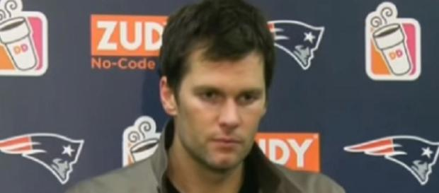 Tom Brady wore gloves on both hands during Thursday's practice (Image Credit: NFL Total/YouTube)