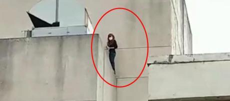 Jovem tenta pular de cima de prédio
