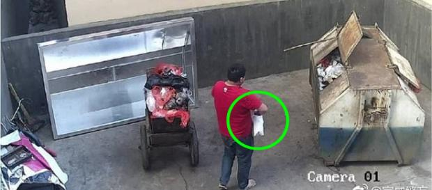 Homem jogou sua filha recém-nascida em lixeira (Crédito: Yunnan Daily)