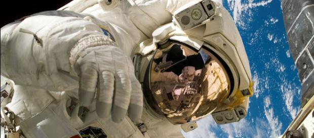 ISS astronaut demonstrates heat shield repair techniques (Image credit - Michael Edward Fossum, Wikimedia Commons)