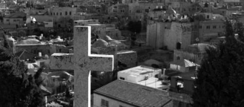 A symbol of Christianity looks out over the disputed city of Jerusalem - Kenneth Reitz - Flickr
