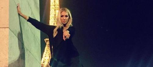 Stassi Schroeder poses in front of the Eiffel Tower. [Photo via Instagram]