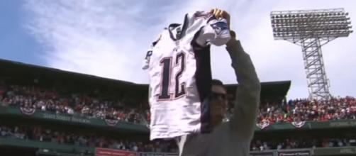 Tom Brady shows the stolen jersey to Boston Red Sox fans after it was recovered (Image Credit: MLB/YouTube)