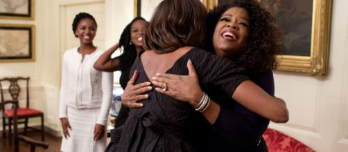 Greeting Oprah in the White House (Image via Obama White House Archives)