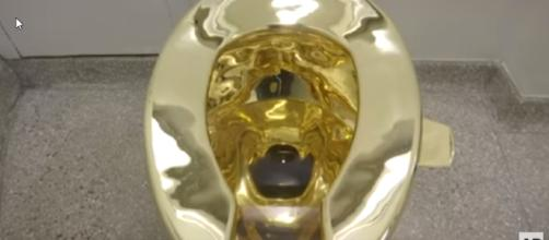 The 14k gold toilet offered to Trump and Melania in place of the Van Gogh they requested. [image source: Associated Press/YouTube screenshot]