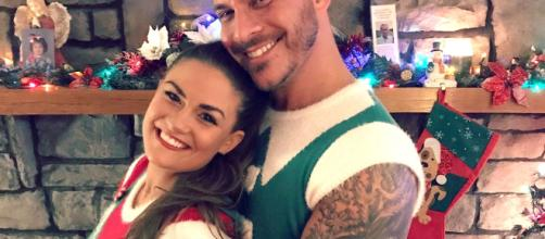 Brittany Cartwright and Jax Taylor pose together on Christmas. [Photo via Instagram]