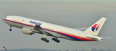 A Malaysian Airlines Boeing 777 takes off during a past flight.- [image via wikimedia commons/Laurent Errera]