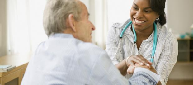 Home healthcare worker checks elderly patient [image credit: Myfuture/Flickr]
