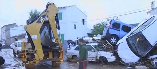 An area of Mallorca in the Balearic Islands suffered flash flooding killing at least 9 people. [Image Guardian News/YouTube]