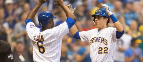 Christian Yelich and Lorenzo Cain have been a hug part of the Brewers winning ways in 2018. [Image via ESPN.com/YouTube]