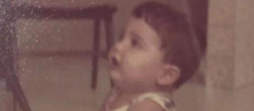 Será que você sabe quem é o garotinho nessa foto?
