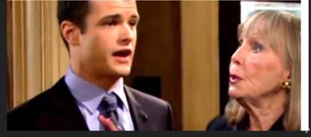 Dina leads Kyle to a secret wall safe in the Abbot mansion. (Image Source: The Young and the Restless Spoilers and recaps-YouTube.)