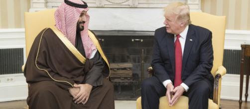 President Donald Trump speaks with Mohammed bin Salman bin Abdulaziz Al Saud. [Image source: Shealah Craighead | Wikimedia Commons]