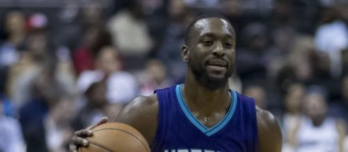 Kemba Walker, averaging 35 points per game, is breaking records to open Charlotte's season. Image Credit- Keith Allison, Wikimedia Commons