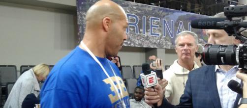 LaVar Ball being interviewed by Jeff Goodman of ESPN in Lithuania. [image source: Janina Fotobank- Wikimedia Commons]