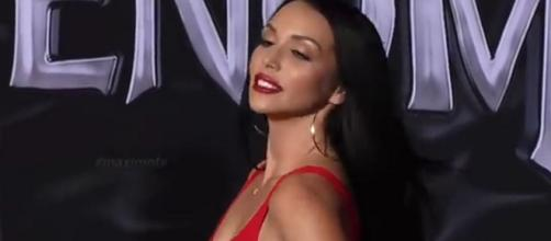 Bravo star Scheana Marie shared a photo with Adam Scott that has fans thinking they are a couple. [Image Source: MaximoTV - YouTube]