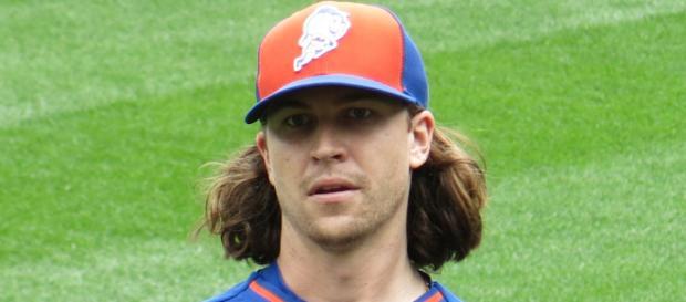 Jacob deGrom when he had hair that went below his shoulders. [image source: D. Benjamin Miller- Wikimedia Commons]