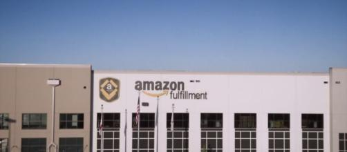 Starting Nov. 1, Amazon will raise its minimum wage to $15 for all employees. [Image source: CNBC - YouTube