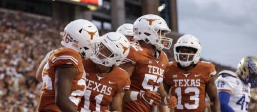 Texas takes on Oklahoma in the Red River Rivalry and leads at halftime [Image via Big 12 conference/YouTube]