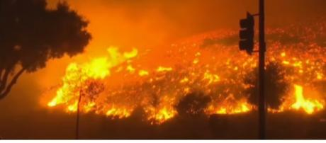 California Sees Most Destructive Wildfire in History. [Image source/RT America YouTube video]