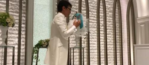 Akihiko Kondo, 35, married hologram represented by plushie toy of Hatsune Miku. [Image Source: World News - YouTube]
