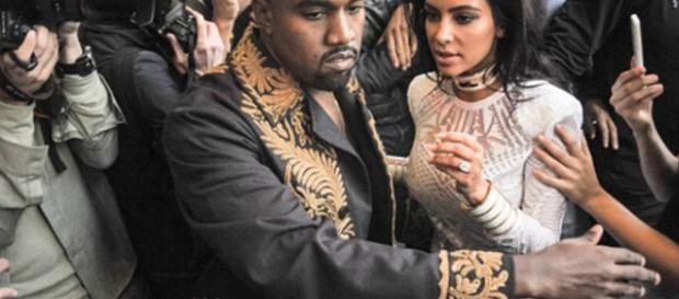 Kanye West and Kim Kardashian-West had private fire fighters save mansion. [Image Source:Rap Critic - YouTube]