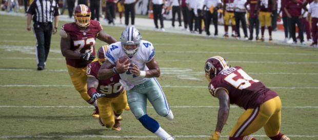 Quarterback Dak Prescott of the Dallas Cowboys hopes to run past the Washington Redskins on Thanksgiving Day. [Image via Flickr -- Keith Allison]