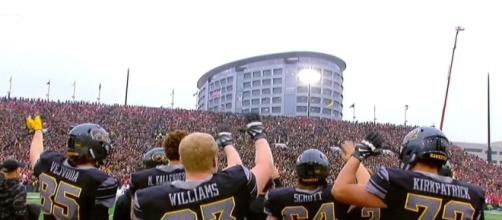Iowa fans claim Husker players didn't wave at hospital.[Image via Inside Edition/YouTube]