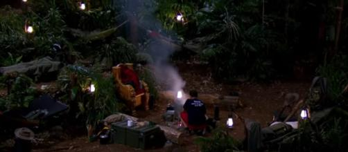 Nick cooks bean burgers while his campmate share a feast in Snake Rock (Image credit: I'm A Celebrity...Get Me Out Of Here! ITV/ YouTube.com)