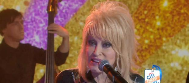 Dolly Parton got up early to sing Girl in the Movies on Today. [Image source: TODAY-YouTube]