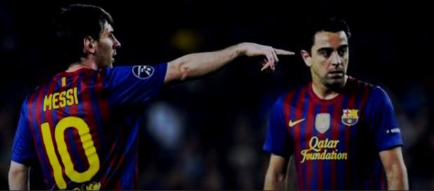 Messi e Xavi [Imagem via YouTube]