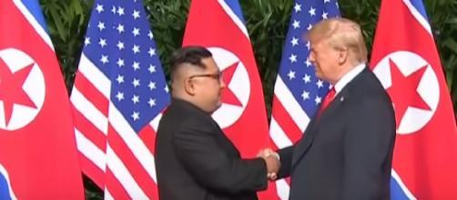 Moment Kim Jong-un and Donald Trump share historic handshake [Image courtesy – Guardian News YouTube video]