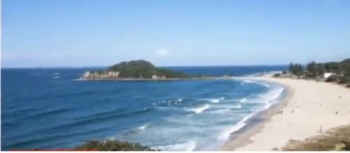 View of Matata beach from where NZ fisherman rescued a baby from the ocean. [Image source/News 4 U YouTube video]