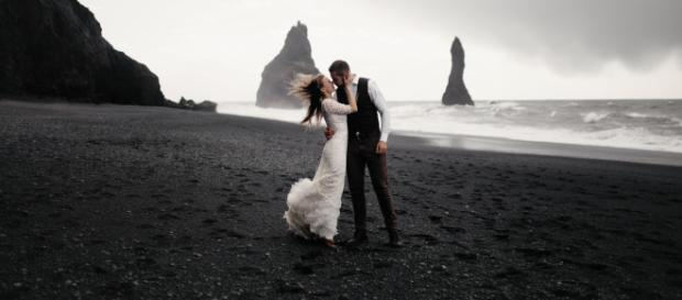 Couple enjoy a winter wedding. Image Credit: Dmitry Schemelev on Unsplash