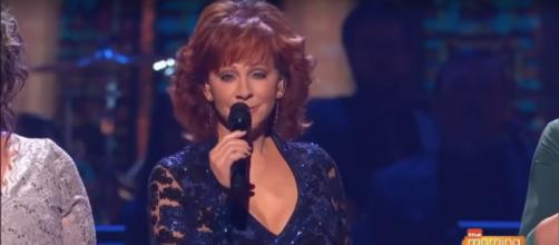 Host Reba McEntire's song with The Isaacs was a moving moment of the 2018 CMA Country Christmas. - [KGUN9 / YouTube screencap]