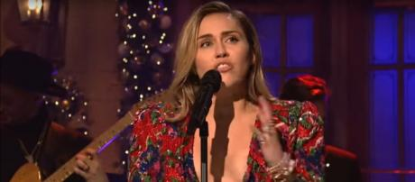 Miley Cyrus closed her SNL performance with wide-hearted wishes and 'Merry Christmas.' - [SNL / YouTube screencap]