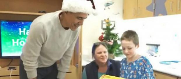 Barack Obama delivers presents to kids at Children's National hospital in DC. [Image source/Channel 14 YouTube video]