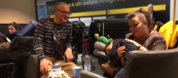 Passengers stranded at Gatwick Airport as rogue drone shuts down skies. [Image source/The Sun YouTube video]