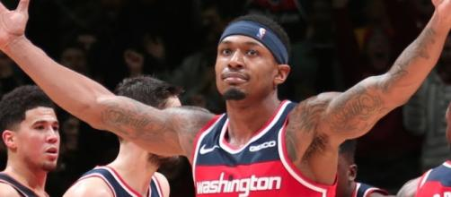 The Wizards' Bradley Beal achieved a 40-point triple-double to help his team win in triple-overtime. [Image via ESPN/YouTube screencap]