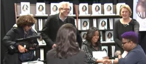 Michelle Obama signs books in New York. [Image source/AP Archive YouTube video]