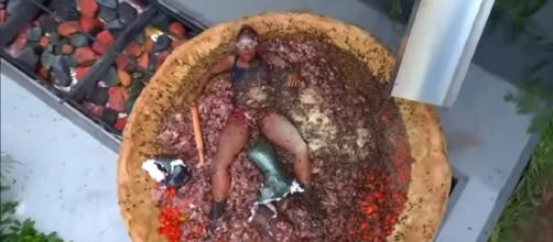Fleur shows that all pizza is good pizza at the Gore Seasons (Image credit: I'm A Celebrity...Get Me Out Of Here!/ YouTube.com)