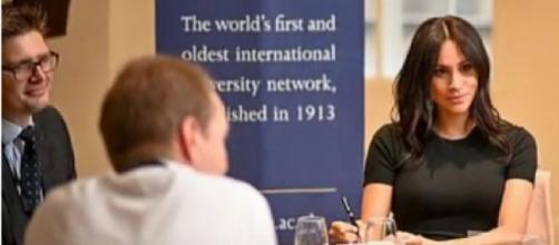 Meghan Markle makes surprise appearance at King's College London. [Image source/USA NEWS YouTube video]