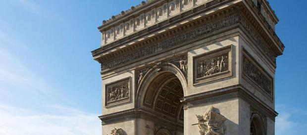 Arc de Triomphe was defaced with graffiti in the P aris riots. [Image Source: Arc de Triomphe 21 October 2010 Flickr photographer Jiuguang Wang]