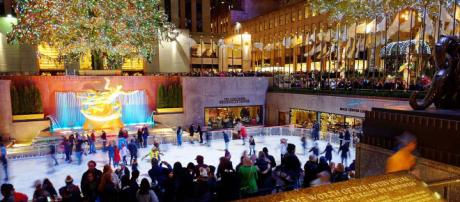 Ice skating at the base of the Rockefeller Christmas Tree, New York. [Image Michael Vadon/Wikimedia]