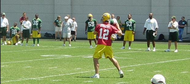Aaron Rodgers set a NFL record for most passes without an interception. [Image Source: Flickr | Dustin Filippini]
