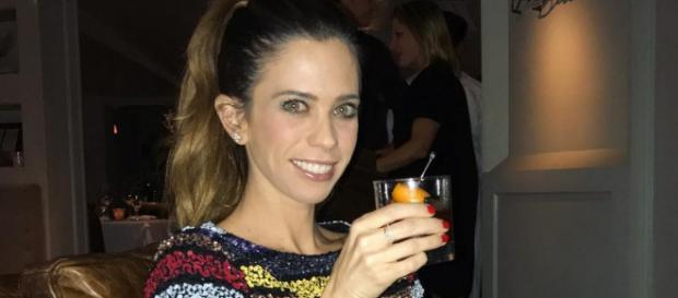 Lydia McLaughlin enjoys a cocktail. [Photo via Facebook]